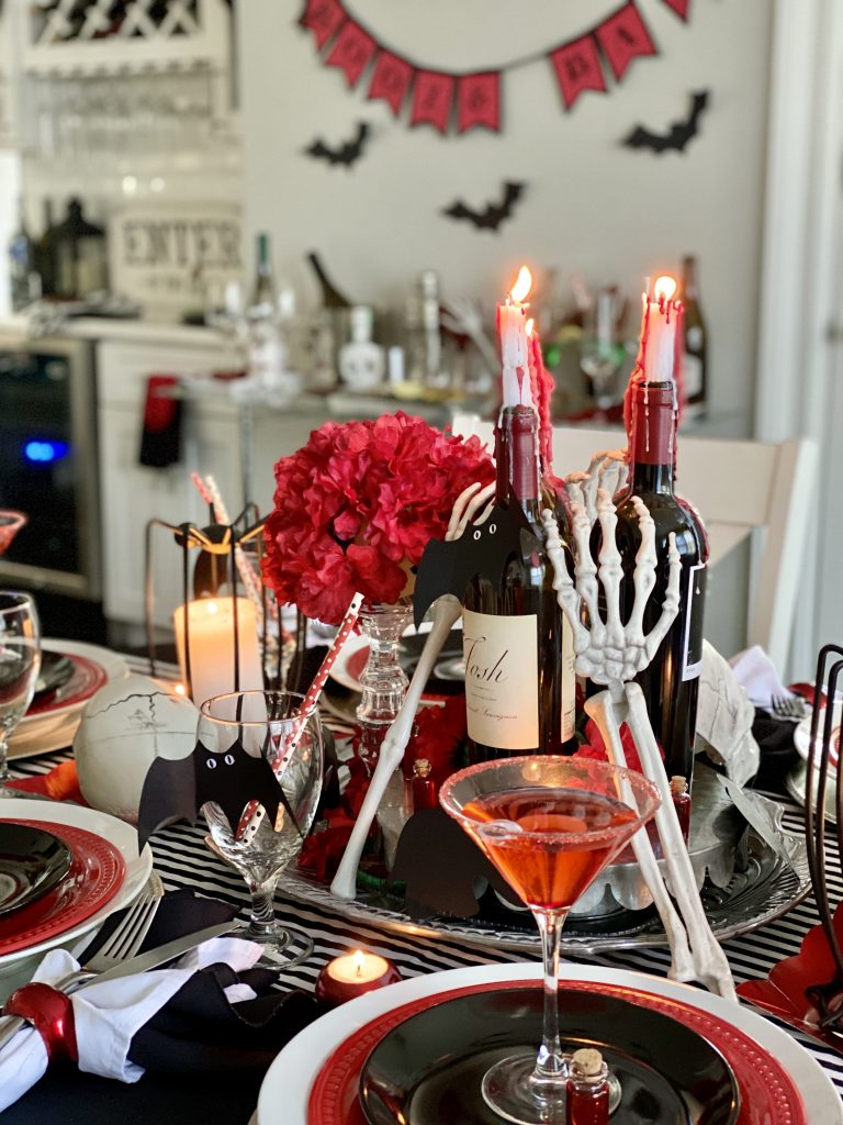 Gorgeous wine bottles for Halloween centerpiece.