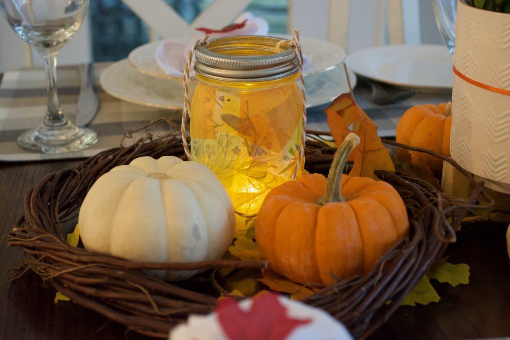 Mason jar lanterns lit up.