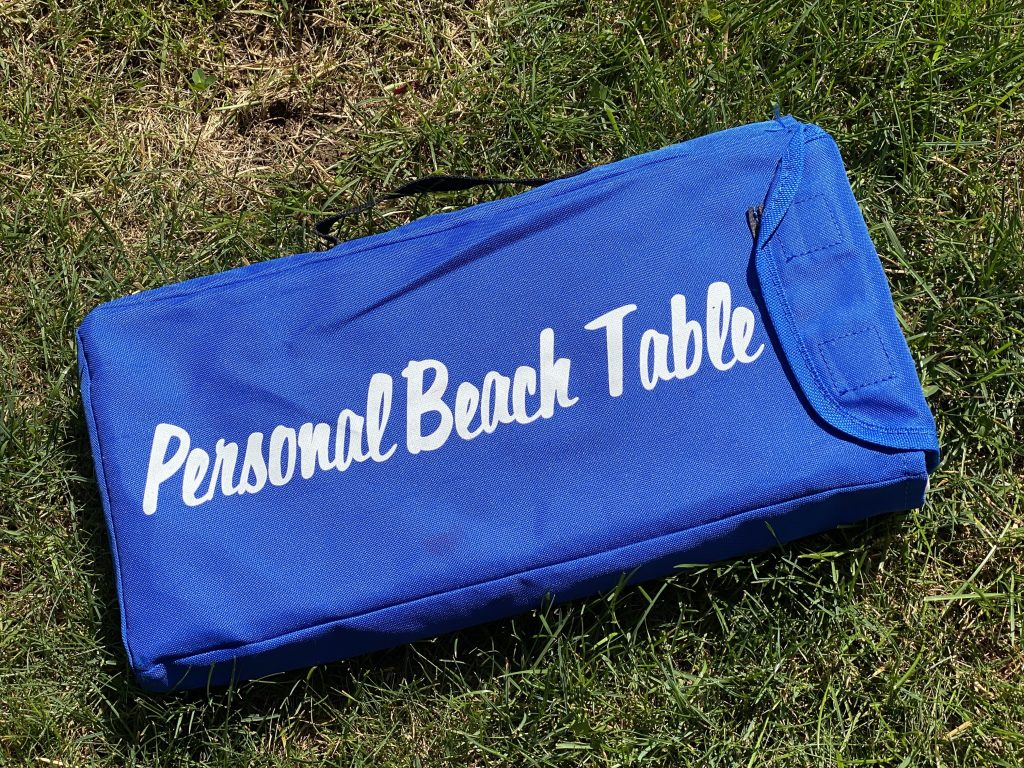 This personal beach table is great for decorating or for eating.