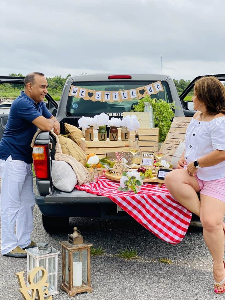 romantic picnic in the back of a pickup truck