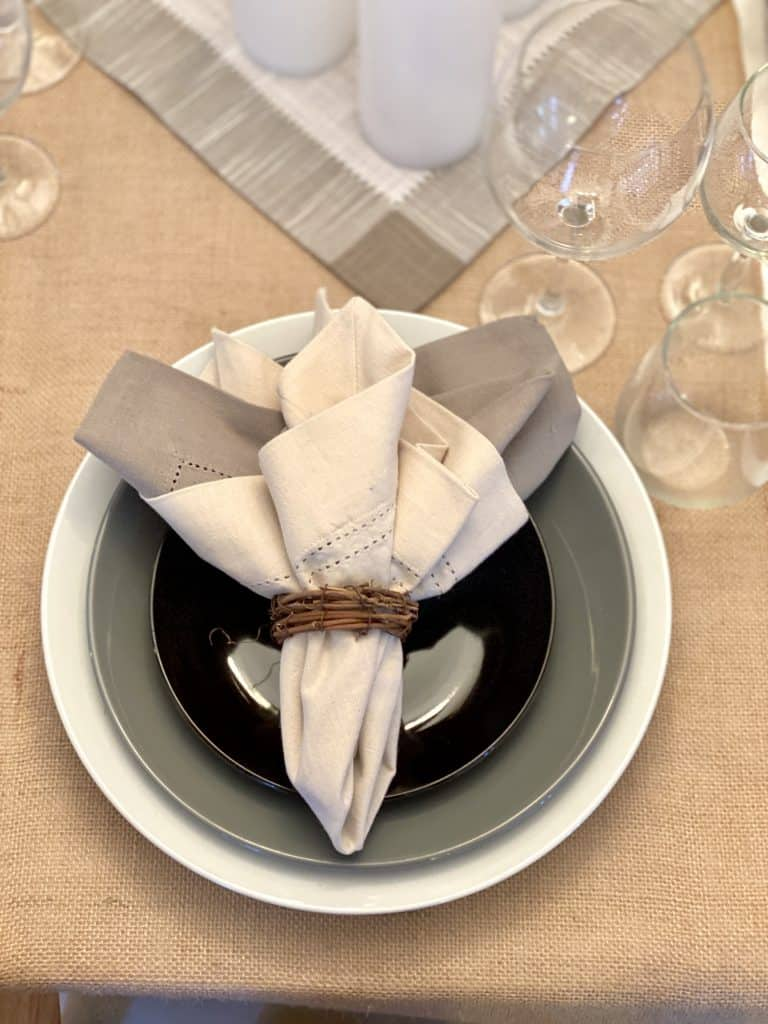 Grey, black, and brown table setting.