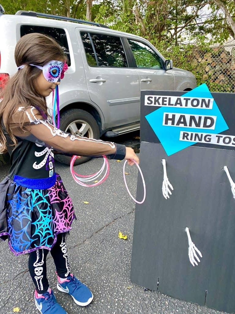 Skeleton hand ring toss game